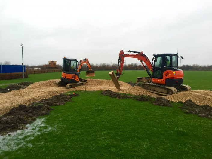 Specialist experienced mountain bike trail construction contractor Conservefor operating five tonne and three tonne 360 excavator to build a new pump track in Morpeth