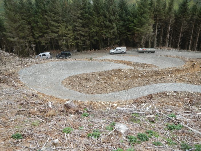 Red grade mountain bike trail completed construction of big berm built by specialist experienced mountain bike trail construction contractor Conservefor, Penmachno, MTB trail build