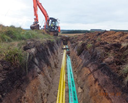 Excavation of windfarm cable trench for low & high voltage cables, fibre optic, earth wire, sanding, installation of warning tape, back filling and landscaping civil engineering work completed by Conservefor specialist trenching and cabling contractor