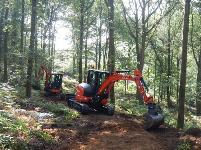 All ability mountain bike trail being built by specialist experienced mountain bike trail construction contractor Conservefor skilled trail building team operating 360 excavators fitted with tilt buckets, Forest of Dean, MTB trail build