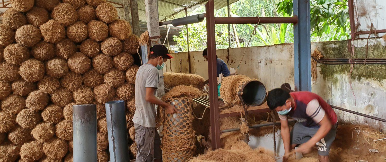 Filling the coir logs with coconut coir
